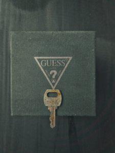 gold key on black leather case