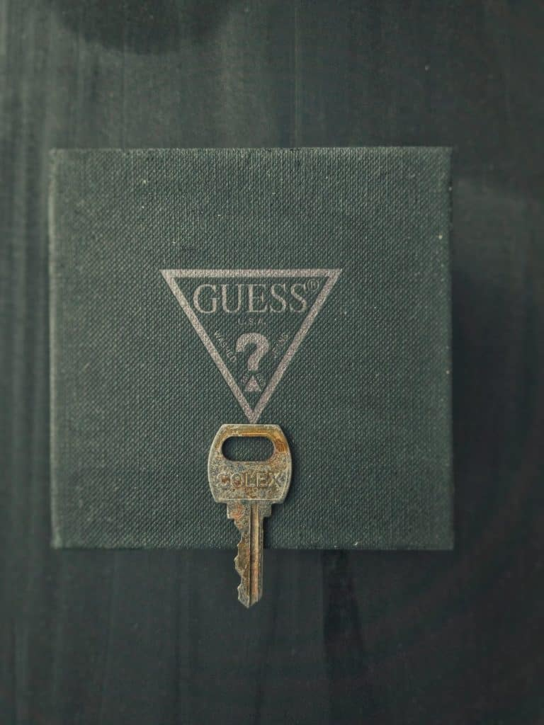 gold key on black leather case